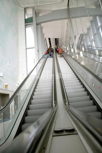 a very long escalator in a public building