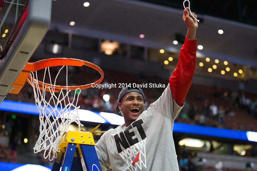 Wisconsin Badgers Riley Dearring cuts down a piece of the net after the Western Regional Final NCAA college basketball tournament game against the Arizona Wildcats Saturday, March 29, 2014 in Anaheim, California. The Badgers won 64-63 (OT). (Photo by David Stluka)