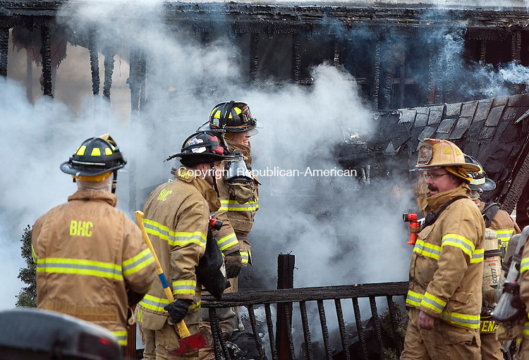NAUGATUCK, CT-030314JS20--Members of the Naugatuck Fire Department and Beacon Hose Company work at the scene of a structure fire that destroyed a house trailer and severely damaged another in a mobile home park at 129 Lewis Street in Naugatuck on Monday. <br /> Jim Shannon Republican-American
