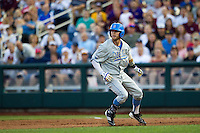 UCLA outfielder Eric Filia (4) is caught in a run down after driving in 2 runs in the fourth inning against the Mississippi State Bulldogs during Game 1 of the 2013 Men's College World Series Final on June 24, 2013 at TD Ameritrade Park in Omaha, Nebraska. The Bruins defeated the Bulldogs 2-1, taking a 1-0 lead in the best of 3 series. (Andrew Woolley/Four Seam Images)