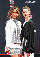 HOLLYWOOD, CA - MAY 14: Halle Berry, Asia Kate Dillon, at the Keanu Reeves Hand And Foot Print Ceremony at the TCL Chinese Theatre IMAX in Hollywood, California on May 14, 2019. <br /> CAP/MPIFM<br /> &copy;MPIFM/Capital Pictures