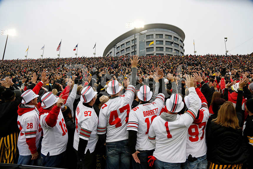 Ohio State Buckeyes fans wave to children and families in the UI Stead Family Children's Hospital at the end of the 1st quarter at Kinnick Stadium in Iowa City on November 4, 2017.  [Kyle Robertson\Dispatch]