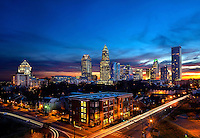 Skyline photography of the Charlotte NC downtown center city. Photo taken in December 2012 from the northeast edge of town (off Brookshire Freeway) toward Charlotte. Image is part of a series of Charlotte skyline photographs taken over several years, from more than a dozen angles, and with different weather scenes. Images are available for licensing and as framed art.