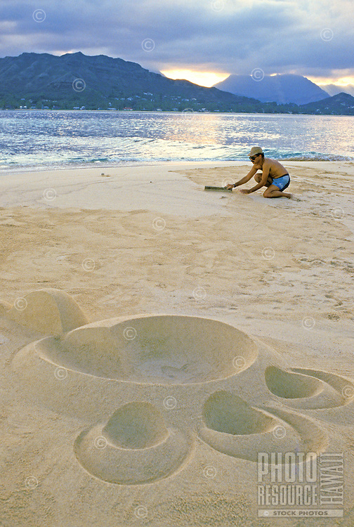 Sand sculpture artist Barry Peckham on one of moku lua islands of the coast of Lanikai, Windward Oahu