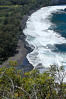 View of black sand beach from Waipi'o lookout, on the north-eastern Hamakua Coast of Big Island, Hawaii