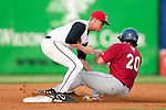 Carolina Mudcats second baseman Brian Cleveland puts the tag on Huntsville's Jeff Eure (20) at Five County Stadium in Zebulon, NC, Thursday, July 20, 2006.
