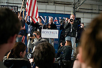 Photographers take pictures of the crowd at a Ron Paul rally at Jet Aviation in Nashua, New Hampshire, on Jan. 6, 2012.  Paul is seeking the 2012 GOP Republican presidential nomination.