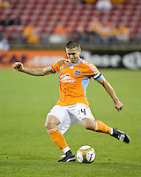 Houston Dynamo defender Wade Barrett (24) strikes the ball  Houston Dynamo tied Atlante FC 1-1 at Robertson Stadium in Houston, TX on February 24, 2009 in CONCACAF Champions League play .  Photo by Wendy Larsen/isiphotos.com