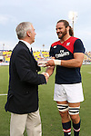 17 August 2013: Todd Clever (USA) (right) receives a crystal eagle in recognition of playing 50 caps (appearances) for the U.S. national team. The United States Men's National Rugby Team played the Canada Men's Nationa Rugby Team at Blackbaud Stadium in Charleston, South Carolina in the first leg of their 2015 Rugby World Cup Qualifying Series. Canada won the game 27-9.