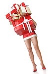 Woman with lots of Christmas gifts with only legs visible. Isolated on white background with clipping path.