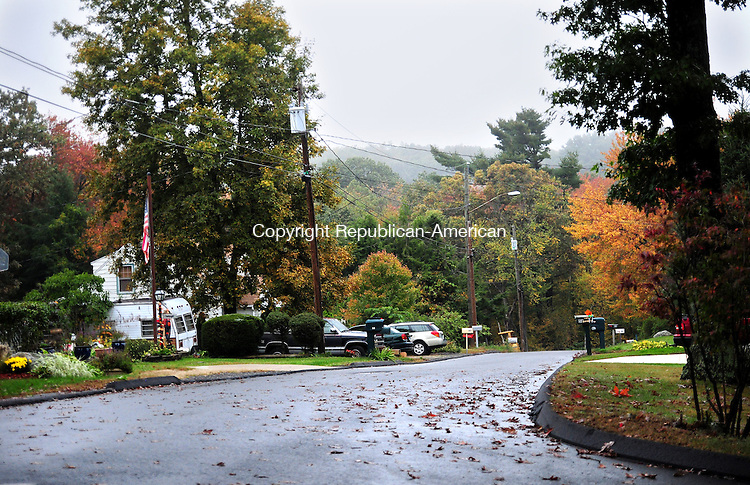 PLYMOUTH, CT, 04 OCT 12-100412AJ01- Lakeview Road, now ends abruptly at the woods. A  contractor developing lots in the neighborhood near Fall Mountain Lake will be connecting it to Highland Road. Alec Johnson/ Republican-American