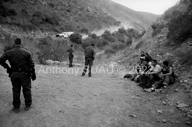 Dulzura, California<br /> August 16, 2007<br /> <br /> A special-operations border patrol unit that is air-mobile captures a group of illegal immigrants just north of the Mexican border.<br /> <br /> Within minutes of their arrival  - a five men team, located on the mountain ridge, spots a group heading for the border...The Border Patrol hides in the bushes and jump them as they cross into the USA. The Mexican's are loaded into a Border Patrol truck.