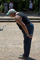 The game of boules, or petanque, is played in cities, towns and villages all over France and is taken extremely seriously at all levels, but not so seriously as to interfere with a smoke, as this player, in the village of Boudou near Moissac, demonstrates.