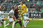 06.10.2019, Borussia-Park - Stadion, Moenchengladbach, GER, DFL, 1. BL, Borussia Moenchengladbach vs. FC Augsburg, DFL regulations prohibit any use of photographs as image sequences and/or quasi-video<br /> <br /> im Bild Yann Sommer (#1, Borussia Moenchengladbach) pariert den bevor Ja-cheol Koo (#19, FC Augsburg) ihn erreicht<br /> <br /> Foto © nordphoto/Mauelshagen