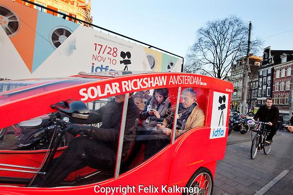 Amsterdam, 20 november 2010.International Documentary Filmfestival Amsterdam IDFA.Frederick Wiseman traveling by Solar powered Rickshaw.Photo by Felix Kalkman