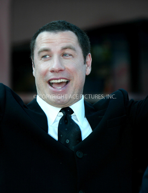 John Travolta at the premiere of 'A Love Song for Bobby Long' during the Venice Film Festival. Palazzo Del Cinema, Venice, Italy, 2 September 2004. ..FAMOUS PICTURES AND FEATURES AGENCY.tel  +44 (0) 20 7731 9333.fax +44 (0) 20 7731 9330.e-mail info@famous.uk.com.www.famous.uk.com.FAM13441