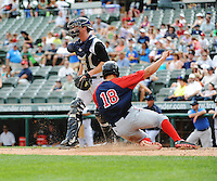 Portland Sea Dogs infielder Garin Cecchini (18) scores as Trenton Thunder catcher Jeff Farnham waits for throw during game played at ARM & HAMMER Park on June 23, 2013 in Trenton, NJ.  Portland defeated Trenton 11-0.  (Tomasso DeRosa/Four Seam Images)