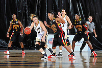 25 November 2011:  FIU guard Zsofia Labady (3) recovers a loose ball while being defended by Maryland guard-forward Alyssa Thomas (25) in the first half as the University of Maryland Terrapins defeated the FIU Golden Panthers, 84-52, at the U.S. Century Bank Arena in Miami, Florida.