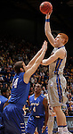 SIOUX FALLS, SD - MARCH 11:  Tony Fiegen #34 of South Dakota State shoots over Joe Reed #44 of IPFW during their semi-final game at the 2013 Summit League Basketball Championships Monday at the Sioux Falls Arena.  (Photo by Dick Carlson/Inertia)