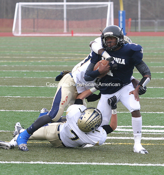 MIDDLETOWN, CT- 02 DECEMBER 2012 120212JW07 - Ansonia #1 Jaiquan McKnight carries against the tacle of Hyde Leadership #7 Seth Beaton and #53 Kahlil Morant during the Class S state semifinals at Middletown High School Sunday afternoon. Ansonia won 41-13..Jonathan Wilcox Republican American..