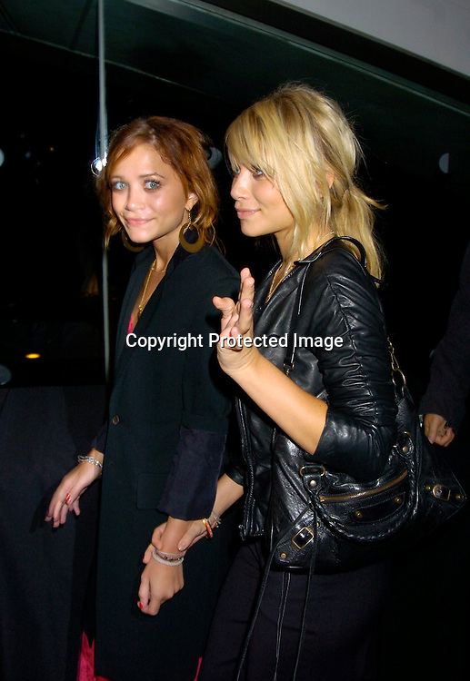 Mary-Kate Olsen and Ashley Olsen ..at Coty's 100th Anniversary Celebration  on September 12, 2004 at the  American Museum of Natural Historys Rose Center for Earth and Space ..Photo by Robin Platzer, Twin Images