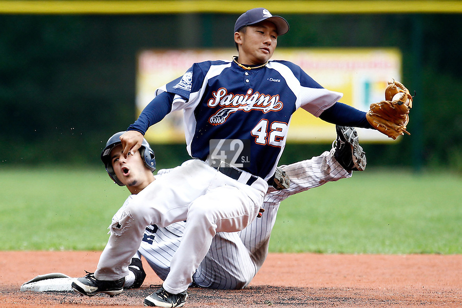 17 July 2011: Daisuke Dice Ikenaga of the Savigny Lions tags out Maxime Lefevre of the Rouen Huskies during the 2011Challenge de France final match won 6-4 by the Rouen Huskies over the Savigny Lions, at Stade Pierre Rolland, in Rouen, France.
