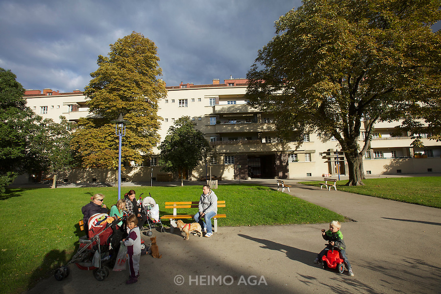 Vienna, Karl-Marx-Hof. Families enjoying the late afternoon sun in one of the courtyards.