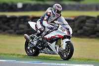 PHILLIP ISLAND, 27 FEBRUARY - James Toseland (GBR) riding the BMW S1000 RR (52) of the BMW Motorrad Italia SBK Team returns to the track after an off at turn 4 during race one of round one of the 2011 FIM Superbike World Championship at Phillip Island, Australia. (Photo Sydney Low / syd-low.com)