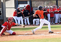 Jeb Brown hits a single on Wednesday March 11 2020 for Rogers Heritage.