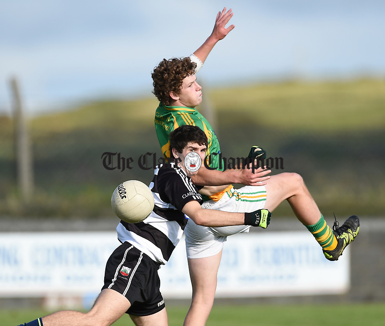 Stephan Ward of Clarecastle in action against Jack O Dea of Kilfenora during their Intermediate Championship Round 3 game in Quilty. Photograph by John Kelly.