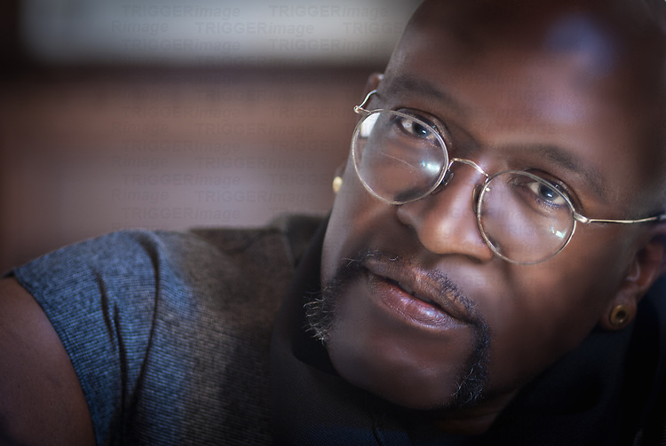 Close up of black male figure wearing glasses
