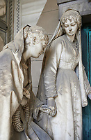 Picture and image of the stone sculpture of 2 mourning sisters at the door of their mothers pyramid shaped tomb, The Rossi Tomb sculpted by G Benetti in 1878. Section D, no 24, The monumental tombs of the Staglieno Monumental Cemetery, Genoa, Italy