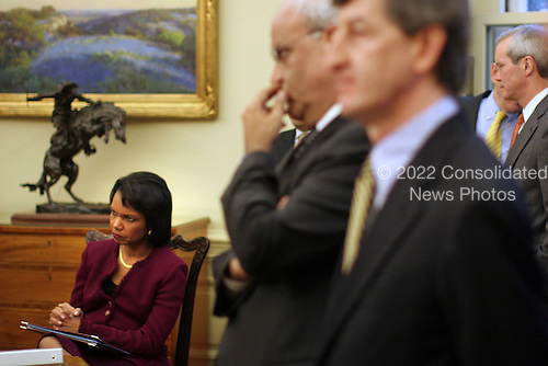 Washington, DC - December 19, 2008 -- United States Secretary of State Condolezza Rice listens as United States President George W. Bush meets with the President Mahmoud Abbas (Abu Mazen) of the Palestinian Authority in the Oval Office of the White House in Washington DC on Friday, December 19, 2008..Credit: Ken Cedeno / Pool via CNP