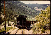 Caboose on end of train hauling crushed rock - Garfield switchback.<br /> D&amp;RGW  Monarch Branch, CO