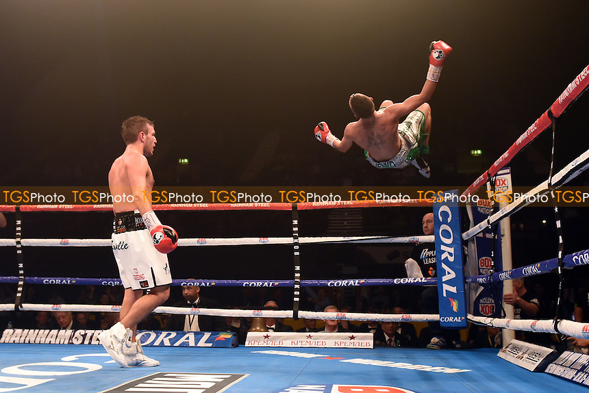 Bobby Jenkinson (silver shorts) defeats Lewis Pettitt during a Boxing Show at Wembley Arena, London, England, promoted by Frank Warren on 26/09/2015