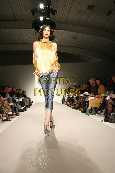 MODEL.Mercedes-Benz Fall 2006 L.A. Fashion Week - Elsie Katz Couture held at Smashbox Studios, Culver City, California, USA..March 20th, 2006.Photo: Zach Lipp/AdMedia/Capital Pictures.Ref: ZL/ADM.catwalk runway full length yellow satin top blue cropped trousers.www.capitalpictures.com.sales@capitalpictures.com.© Capital Pictures.