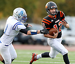 SIOUX FALLS, SD - OCTOBER 16:  Jack Schelhaas #12 from Washington tries to turn the corner past Nathan Trotter #9 from Rapid City Stevens in the first half of their game Friday night at Howard Wood Field. (Photo by Dave Eggen/Inertia)