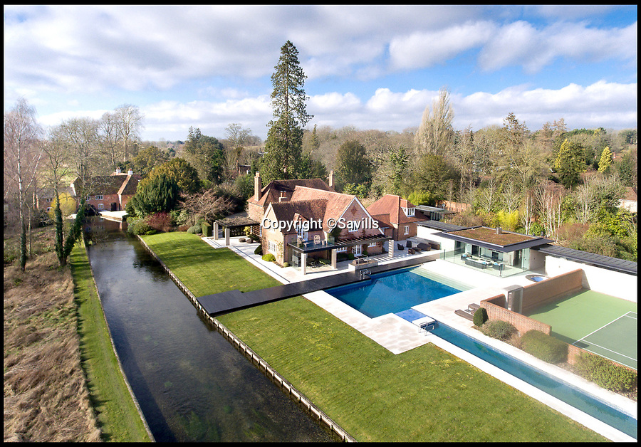 BNPS.co.uk (01202)558833<br /> Pic:   Savills/BNPS<br /> <br /> A stunning riverside home with all the latest mod cons hidden behind its Grade II listed exterior is on the market for £7.5m.<br /> <br /> Lower Chilland House has everything a modern country gent or lady might want - with its own cinema, spa and swimming lap pool.<br /> <br /> The property in the village of Martyr Worthy, near Winchester, Hants, sits in a tranquil setting by the River Itchen and comes with double bank fishing rights.<br /> <br /> Now on the market with Savills, it dates back to the 18th century, but behind its Georgian facade it is actually an ultra-contemporary country retreat.