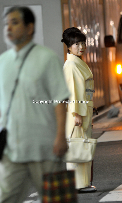 A older high-class hostess, dressed in traditional Kimono on a bar street lined with small exclusive clubs in the up-market  Ginza area of Central Tokyo, 17th September, 2008.<br />