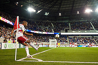 Thierry Henry (14) of the New York Red Bulls takes a corner kick during a Major League Soccer (MLS) match at Red Bull Arena in Harrison, NJ, on September 29, 2012.