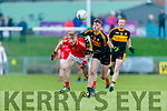 Evan Cronin, East Kerry in action against Mark O'Shea, Dr Crokes  during the Kerry County Senior Club Football Championship Final match between East Kerry and Dr. Crokes at Austin Stack Park in Tralee, Kerry.
