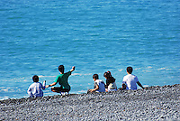 Children, beach, stoney, Kaikoura, South Island, New Zealand, 201004085212..Copyright Image from Victor Patterson, 54 Dorchester Park, Belfast, United Kingdom, UK. Tel: +44 28 90661296. Email: victorpatterson@me.com; Back-up: victorpatterson@gmail.com..For my Terms and Conditions of Use go to www.victorpatterson.com and click on the appropriate tab.