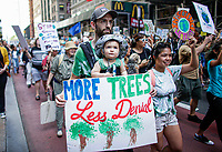 NEW YORK, NY - SEPTEMBER 20: A family attend a rally for action on climate change on September 20, 2019 in New York City. People world wide participate in a day of protest calling for urgent action to fight climate change.(Photo by Kena Betancur/VIEWpress)