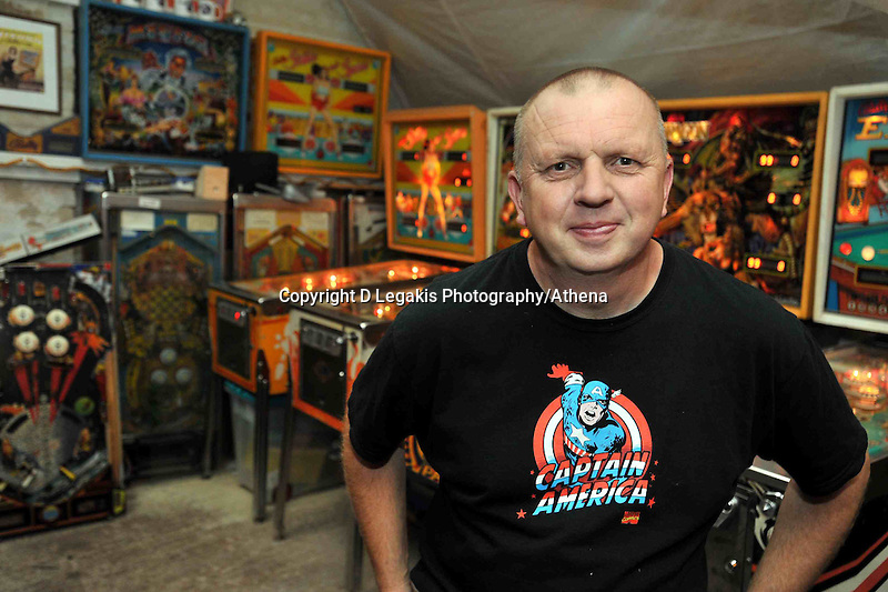 COPY BY TOM BEDFORD<br /> Pictured: David Rolfe in 2010 with some of his pinball machines.<br /> Re: Pinball widow Elaine Rolfe from Abergavenny, south Wales, whose late husband David left her 30 pinball machines.