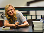 MIAMI, FL - AUGUST 01: Chloe Grace Moretz signs copies of the book 'If I Stay' at Barnes & Noble Booksellers on Friday August 1, 2014 in Miami, Florida. (Photo by Johnny Louis/jlnphotography.com)
