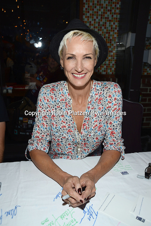 Amra-Fay Wright attends the 27th Annual Broadway Flea Market and Grand Auction benefitting Broadway Cares/ Equity Fights Aids on September 22, 2013 at Shubert Alley in New York City.