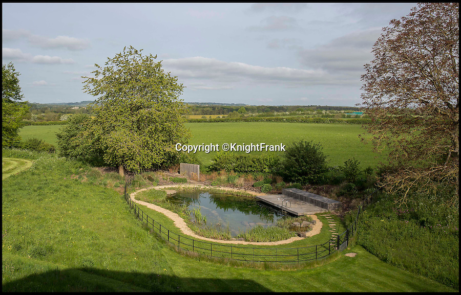 BNPS.co.uk (01202 558833)<br /> Pic: KnightFrank/BNPS<br /> <br /> Fancy a dip... The natural swimming pool.<br /> <br /> Homebuyers can get back to nature in style with this stunning modern barn which comes with its own natural swimming pond.<br /> <br /> From the outside Far End has been cleverly designed to blend into its natural surroundings but inside the £2.95million house is anything but basic.<br /> <br /> The house sits on the edge of Kingham, a village on the Gloucestershire/Oxfordshire borders, and has incredible views of the surrounding Cotswold countryside.