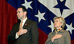 Then Arkansas Governor Mike Huckabee and Senator Hillary Clinton say the Pledge of Allegiance during the First Ladies of Arkansas Luncheon as part of the William Jefferson Clinton Presidential Library dedication Wednesday, Nov 17, 2004 in Little Rock, Arkansas.