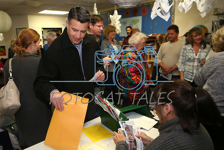 Gov. Brian Sandoval cast the first ballot of his precinct at the Republican caucus at Caughlin Ranch Elementary School in Reno, Nev. on Tuesday, Feb. 23, 2016. Sandoval voted for Rubio but said it was not an endorsement. Cathleen Allison/Las Vegas Review-Journal