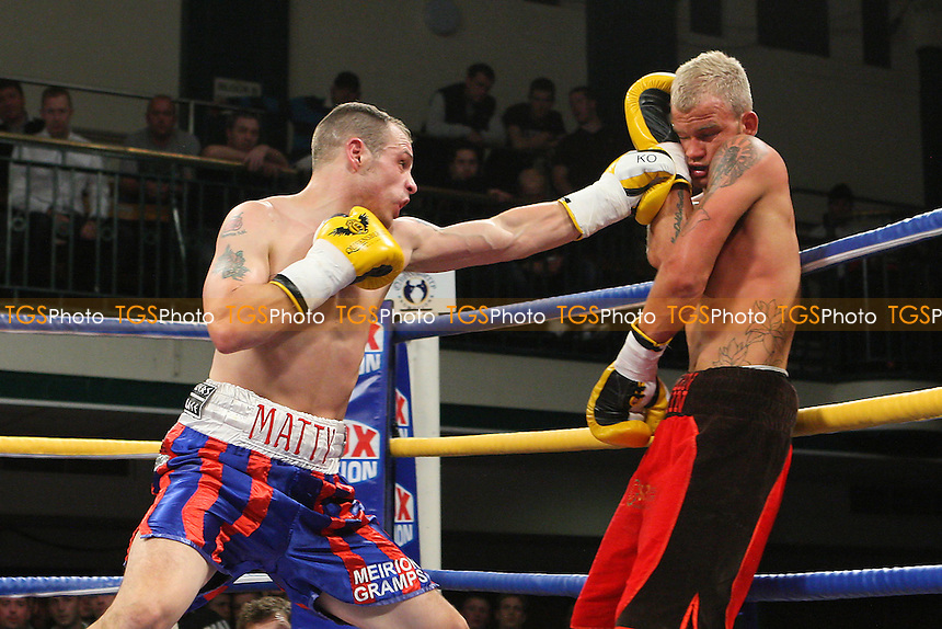 Matty Tew (red/blue shorts) defeats Robin Deakin in a Light-Welterweight boxing contest at York Hall, Bethnal Green, promoted by Queensberry Promotions - 18/11/11 - MANDATORY CREDIT: Gavin Ellis/TGSPHOTO - Self billing applies where appropriate - 0845 094 6026 - contact@tgsphoto.co.uk - NO UNPAID USE.